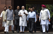 Prime Minister Narendra Modi with his cabinet colleagues at Parliament House on the opening day of the Monsoon Session on July 18 2016 in New Delhi...