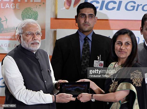 Prime Minister Narendra Modi with ICICI Bank's MD and CEO Chanda Kochhar during the launch of 'Digital Village' project and adopting a village in...