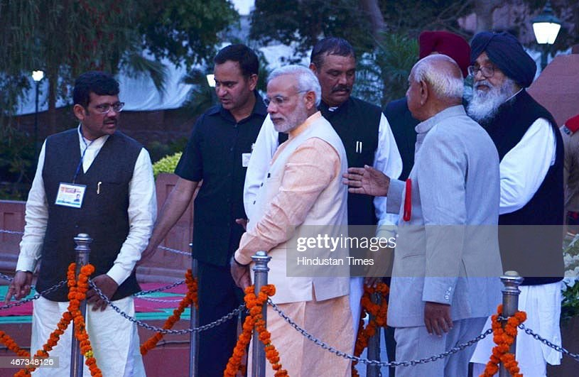Prime Minister <a gi-track='captionPersonalityLinkClicked' href=/galleries/search?phrase=Narendra+Modi&family=editorial&specificpeople=822611 ng-click='$event.stopPropagation()'>Narendra Modi</a> with Punjab Chief Minister <a gi-track='captionPersonalityLinkClicked' href=/galleries/search?phrase=Parkash+Singh+Badal&family=editorial&specificpeople=3634862 ng-click='$event.stopPropagation()'>Parkash Singh Badal</a> and BJP Punjab President Kamal Sharma during their visit to pay tribute at Jallianwala Bagh on March 23, 2015 in Amritsar, India. Prime Minister <a gi-track='captionPersonalityLinkClicked' href=/galleries/search?phrase=Narendra+Modi&family=editorial&specificpeople=822611 ng-click='$event.stopPropagation()'>Narendra Modi</a> paid tributes to freedom fighters Bhagat Singh, Rajguru and Sukhdev at the National Martyrs Memorial Hussainiwala on the anniversary of their martyrdom. He also visited Jallianwala Bagh, Golden Temple and Durgiana Temple on a day-long visit to Punjab.