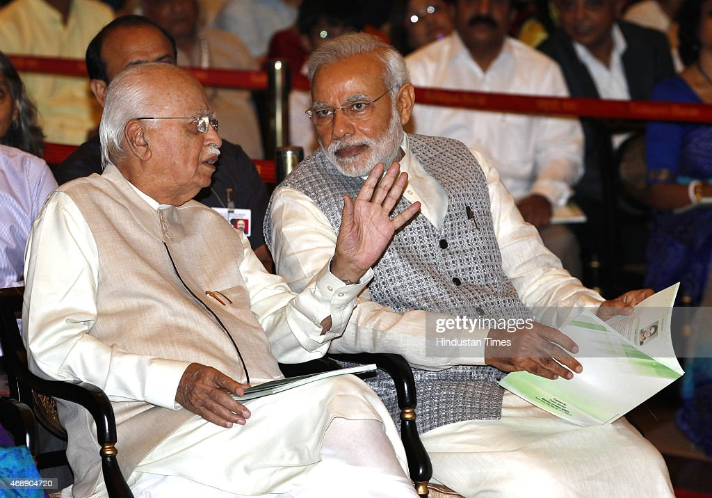 Prime Minister <a gi-track='captionPersonalityLinkClicked' href=/galleries/search?phrase=Narendra+Modi&family=editorial&specificpeople=822611 ng-click='$event.stopPropagation()'>Narendra Modi</a> with senior BJP leader LK Advani during Padma awards ceremony at Rashtrapti Bhawan on April 8, 2015 in New Delhi, India. Bollywood mega-stars Amitabh Bachchan and Dilip Kumar, Shia leader Prince Karim Aga Khan Advocate KK Venugopal, Dharmadhikari of Shri Manjunatha Swamy temple D Veerendra Heggade and nuclear scientist M Ramaswamy Srinivasan were given country's second highest civilian award Padma Vibhushan. Around 50 eminent persons from different fields were bestowed with the three categories of Padma awards by President Pranab Mukherjee today.
