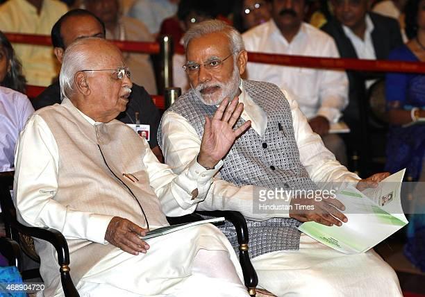 Prime Minister Narendra Modi with senior BJP leader LK Advani during Padma awards ceremony at Rashtrapti Bhawan on April 8 2015 in New Delhi India...