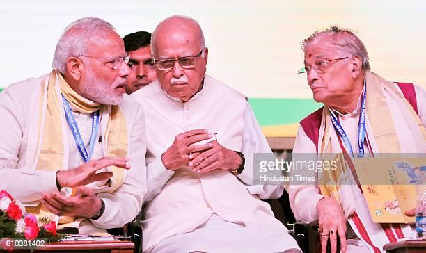 Prime Minister Narendra Modi with senior BJP leaders LK Advani Murali Manohar Joshi and others during the BJP public meeting on September 25 2016 in...