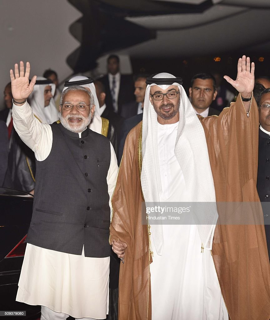 Prime Minister Narendra Modi with Sheikh Mohamed bin Zayed Al Nahyan, Crown Prince of Abu Dhabi, after he arrived here on a three-day visit, at Palam Technical Area on February 10, 2016 in New Delhi, India. The crown prince is being accompanied by a high-level delegation comprising Cabinet Ministers, senior officials and business leaders. India-UAE relationship is focus on new areas of cooperation like defence production in India, security, counter-terrorism, in nuclear and space sector, in energy sector. Delegation-level discussions will be held here between Modi and Sheikh Mohamed on Thursday evening and then the agreements will be signed.