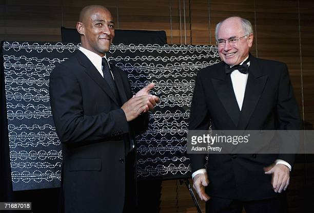 Prime Minister of Australia John Howard and Wallabies Captain George Gregan at The George Gregan Dinner at ARIA Restaurant on August 21 2006 in...