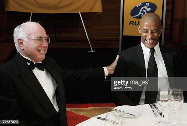 Prime Minister of Australia John Howard and Wallabies Captain George Gregan share a laugh at The George Gregan Dinner at ARIA Restaurant on August 21...