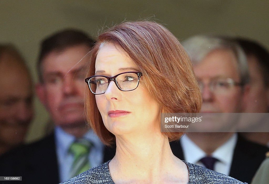 Prime Minister of Australia Julia Gillard (C), former Prime Minister of Australia Kevin Rudd (R) and former Speaker, Peter Slipper (L) look on as they leave the State Funeral for former speaker Joan Child on March 5, 2013 in Melbourne, Australia. Joan Child, the first female speaker of federal parliament passed away on February 23 at the age of 91.