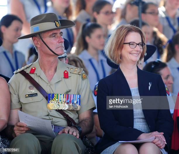 Prime Minister of Australia Julia Gillard sits with Brigadier Shane Caughey during a commemorative service on April 25 2013 in Townsville Australia...