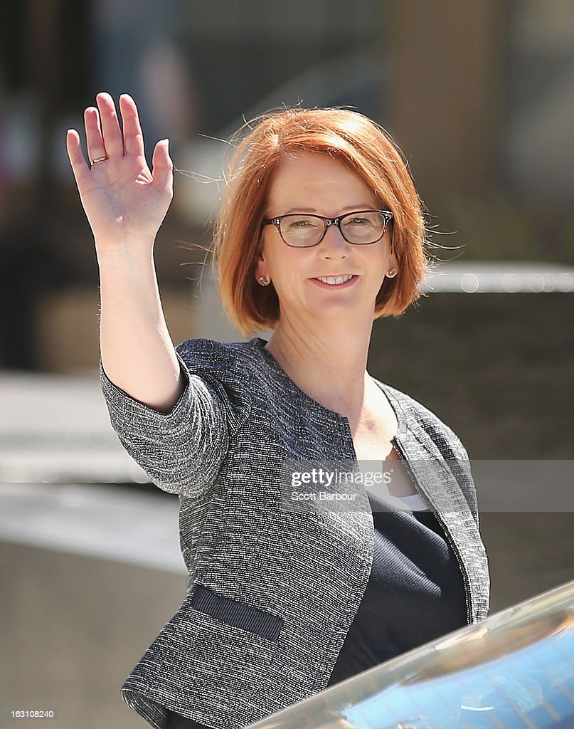 Prime Minister of Australia Julia Gillard waves as she leaves the State Funeral for former speaker Joan Child on March 5, 2013 in Melbourne, Australia. Joan Child, the first female speaker of federal parliament passed away on February 23 at the age of 91.