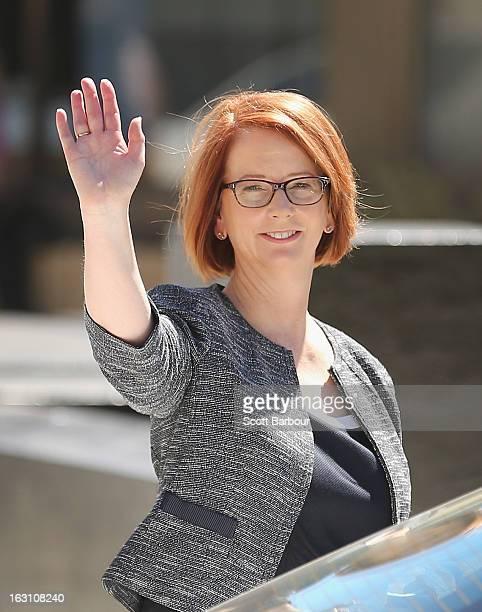 Prime Minister of Australia Julia Gillard waves as she leaves the State Funeral for former speaker Joan Child on March 5 2013 in Melbourne Australia...