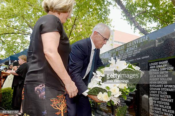 Prime Minister of Australia Malcolm Turnbull and Ms Lucy Turnbull lay a wreath at the memorial wall during the 40th anniversary memorial service for...