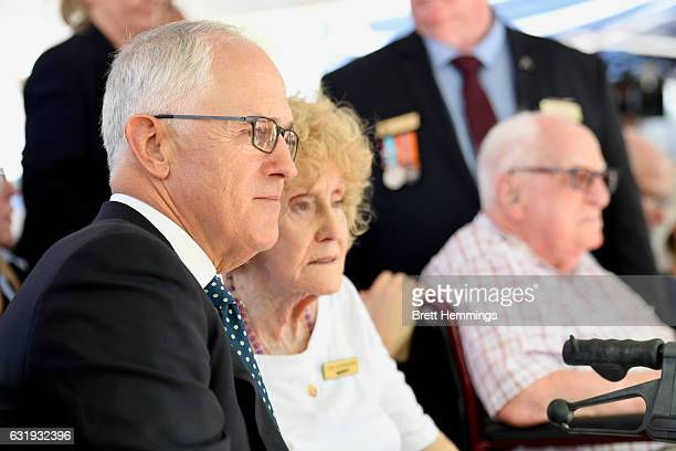 Prime Minister of Australia Malcolm Turnbull speaks with a victim of the disaster during the 40th anniversary memorial service for the Granville...