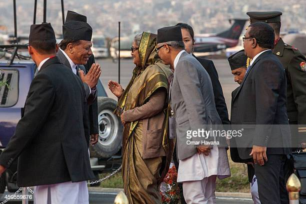 Prime Minister of Bangladesh Sheikh Hasina is greeted by Nepali authorities after she arrives at Tribhuvan International Airport for the 18th SAARC...