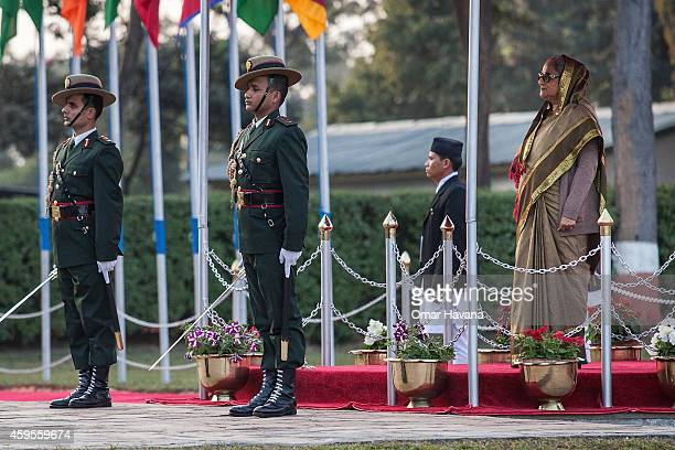 Prime Minister of Bangladesh Sheikh Hasina listens to the National Anthem of his country upon his arrival for the 18th SAARC Summit on November 25...