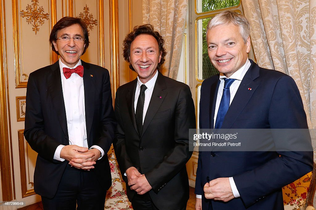 Prime Minister of Belgium Elio Di Rupo, Stephane Bern and Minister of Foreign Affairs of Belgium Didier Reynders attend the King Philippe of Belgium and Queen Mathilde Of Belgium's visit to the Residence of the Ambassador of Belgium during a One Day Official Visit on February 6, 2014 in Paris, France.