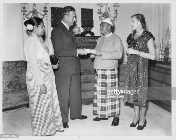 Prime Minister of Burma U Nu presenting a cheque to Earl Mountbatten on behalf of the Army Amenities Fund London June 22nd 1955