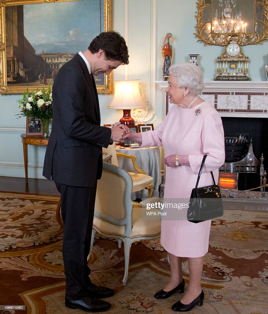Prime Minister of Canada Justin Trudeau shake hands with Queen Elizabeth II during a private audience at Buckingham Palace on November 25, 2015 in London, England. This is the first visit of Trudeau in Britain since his election as Canadas Prime Minister.