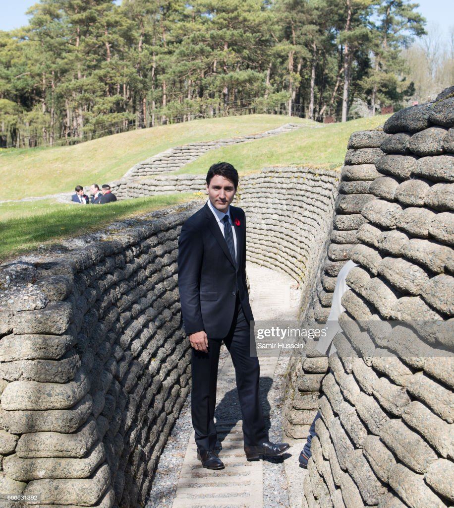 Prime Minister of Canada Justin Trudeau walks through a trench during the commemorations for the 100th anniversary of the battle of Vimy Ridge on April 9, 2017 in Lille, France.