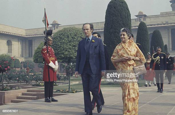 Prime Minister of Canada Pierre Trudeau pictured with Indira Gandhi Prime Minister of India as they walk together through a palace courtyard in Delhi...