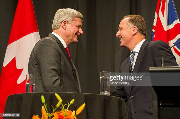 Prime Minister Of Canada Stephen Harper and Prime Minister of New Zealand John Key take part in a joint press conference at the Sky City Grand Hotel...