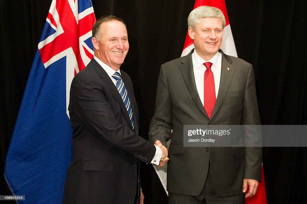 Prime Minister of Canada <a gi-track='captionPersonalityLinkClicked' href=/galleries/search?phrase=Stephen+Harper+-+Politician&family=editorial&specificpeople=690870 ng-click='$event.stopPropagation()'>Stephen Harper</a> (R) shakes hands with Prime Minister of New Zealand <a gi-track='captionPersonalityLinkClicked' href=/galleries/search?phrase=John+Key&family=editorial&specificpeople=2246670 ng-click='$event.stopPropagation()'>John Key</a> after arriving in Auckland on November 14, 2014 at the Sky City Grand Hotel in Auckland, New Zealand. World economic leaders will all travel to Brisbane for the G20 Leadership Summit November 15-16.