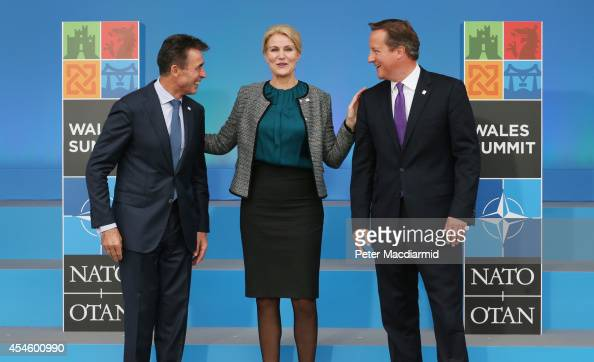 Prime Minister of Denmark Helle ThorningSchmidt stands with NATO Secretary General Anders Fogh Rasmussen and British Prime Minister David Cameron at...