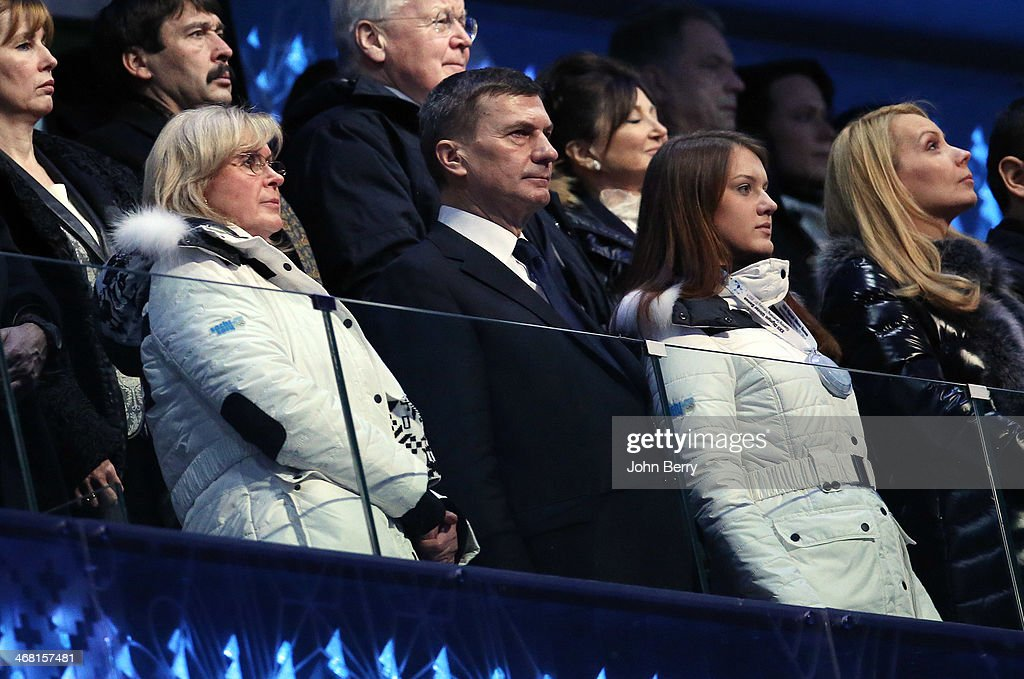 Prime Minister of Estonia <a gi-track='captionPersonalityLinkClicked' href=/galleries/search?phrase=Andrus+Ansip&family=editorial&specificpeople=566399 ng-click='$event.stopPropagation()'>Andrus Ansip</a>, his wife Anu Ansip and their daughter cheer for the competitors of his country during the Opening Ceremony of the 2014 Winter Olympic Games at the Fisht Olympic Stadium on February 7, 2014 in Sochi, Russia.