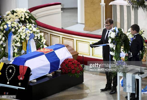 Prime Minister of Finland Juha Sipilae pays tribute next to the coffin of Finland's former President Mauno Koivisto during a state funeral ceremony...