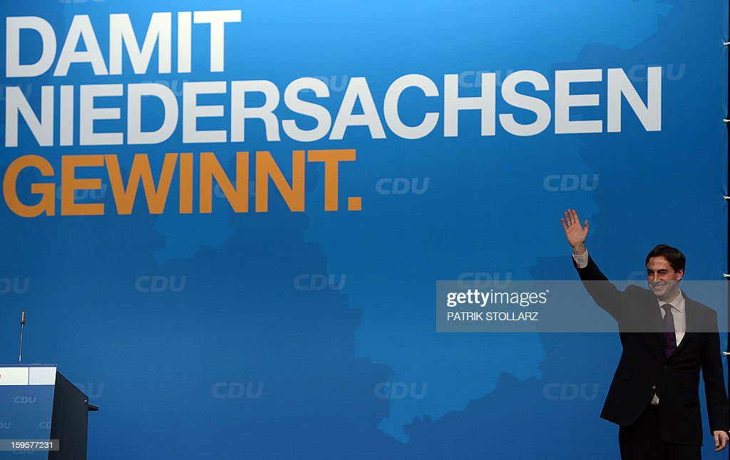 Prime Minister of German Federal State, Lower-Saxony, David McAllister waves after a speech during an election campaign event of the regional Christian Democratic Union party for 2013 state elections in Osnabrueck, northern Germany, on January 16, 2013. McAllister started his election campaign to keep his post as Lower Saxony's State Premier after regional elections on January 20, 2013. AFP PHOTO / PATRIK STOLLARZ