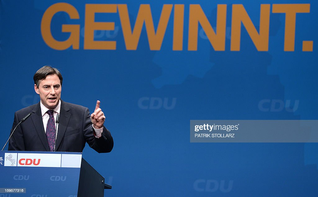 Prime Minister of German Federal State, Lower-Saxony, David McAllister delivers a speech in front of a placard showing the letters 'winning' during an election campaign event of the regional Christian Democratic Union party for the 2013 state elections in Osnabrueck, northern Germany, on January 16, 2013. McAllister started his election campaign to keep his post as Lower Saxony's State Premier after regional elections on January 20, 2013.