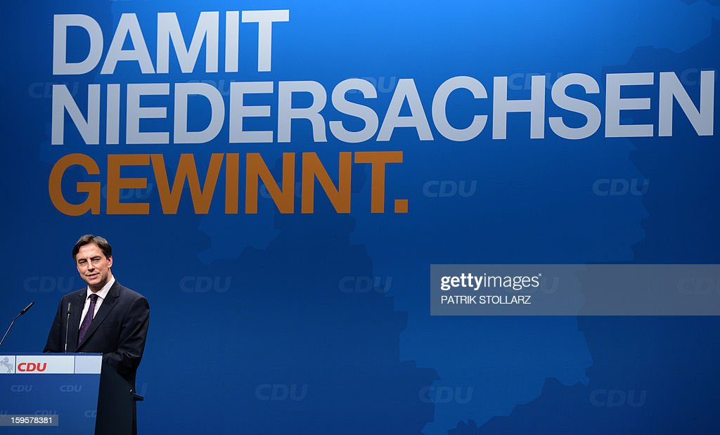 Prime Minister of German Federal State, Lower-Saxony, David McAllister delivers a speech in front of a placard saying 'that Lower-Saxony wins' during an election campaign event of the regional Christian Democratic Union (CDU) party for the 2013 state elections in Osnabrueck, northern Germany, on January 16, 2013.