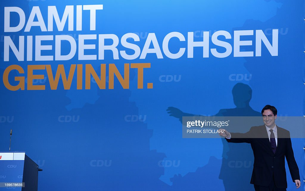 Prime Minister of German Federal State, Lower-Saxony, David McAllister reacts after a speech in front of a placard saying 'that Lower-Saxony wins' during an election campaign event of the regional Christian Democratic Union (CDU) party for the 2013 state elections in Osnabrueck, northern Germany, on January 16, 2013.