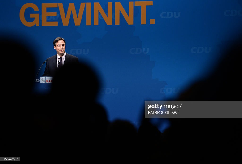 Prime Minister of German Federal State, Lower-Saxony, David McAllister delivers a speech in front of a placard showing the letters 'winning' during an election campaign event of the regional Christian Democratic Union (CDU) party for the 2013 state elections in Osnabrueck, northern Germany, on January 16, 2013.
