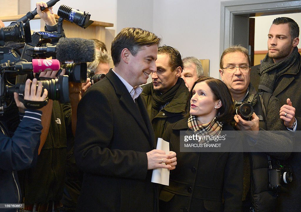 Prime Minister of German Federal State, Lower-Saxony, David McAllister (L) and his wife Dunja McAllister are pictured at a polling station on January 20, 2013 on polling day in Bad Bederkesa, Germany (Lower Saxony).
