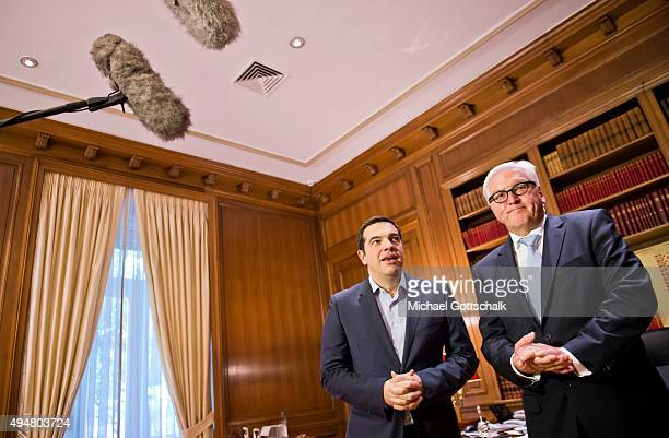 Prime Minister of Greece Alexis Tsipras and German Foreign Minister FrankWalter Steinmeier meet on October 29 2015 in Athens Greece