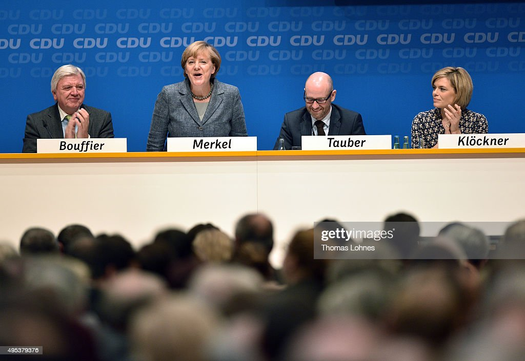 Prime Minister of Hessen <a gi-track='captionPersonalityLinkClicked' href=/galleries/search?phrase=Volker+Bouffier&family=editorial&specificpeople=2371294 ng-click='$event.stopPropagation()'>Volker Bouffier</a>, Peter Tauber and <a gi-track='captionPersonalityLinkClicked' href=/galleries/search?phrase=Julia+Kloeckner&family=editorial&specificpeople=6902085 ng-click='$event.stopPropagation()'>Julia Kloeckner</a> (L-R) applaud the German Chancellor and Chairwoman of the German Christian Democrats (CDU) <a gi-track='captionPersonalityLinkClicked' href=/galleries/search?phrase=Angela+Merkel&family=editorial&specificpeople=202161 ng-click='$event.stopPropagation()'>Angela Merkel</a> after her speech during CDU regional 'Future Conference' on November 2, 2015 in Darmstadt, Germany. Merkel is facing increasing criticism from members of her own party over her open migrants policy. Germany is expected to register over one million asylum applicants this year and local communities across the country are struggling to accommodate all the newcomers. Merkel has said the influx is unstoppable but has pushed for legislation to allow a faster deportation of rejected asylum applicants.