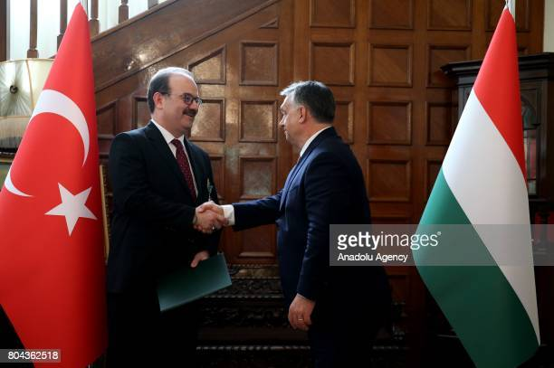 Prime Minister of Hungary Viktor Orban and President of the Turkish Cooperation and Coordination Agency Serdar Cam shake hands after Orban presented...