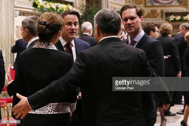 Prime Minister of Hungary Viktor Orban and wife chat with Luxembourg's Prime Minister Xavier Bettel and partner Gauthier Destenay before a meeting...