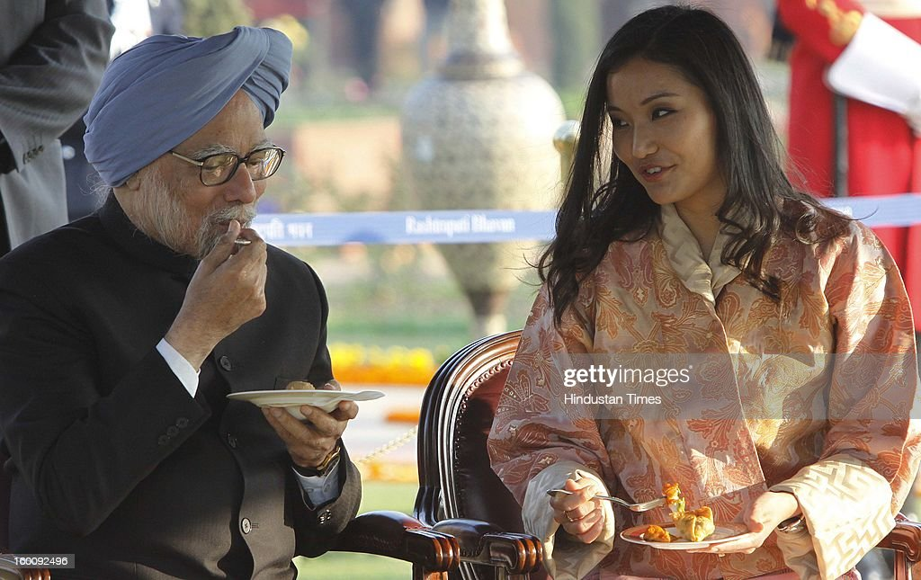 Prime Minister of India Dr. Manmohan Singh with Queen of Bhutan Jetsun Pema at Rashtrapati Bhavan on Republic Day on January 26, 2013 in New Delhi, India. India marked its Republic Day with celebrations held under heavy security, especially in New Delhi where large areas were sealed off for an annual parade of military hardware.