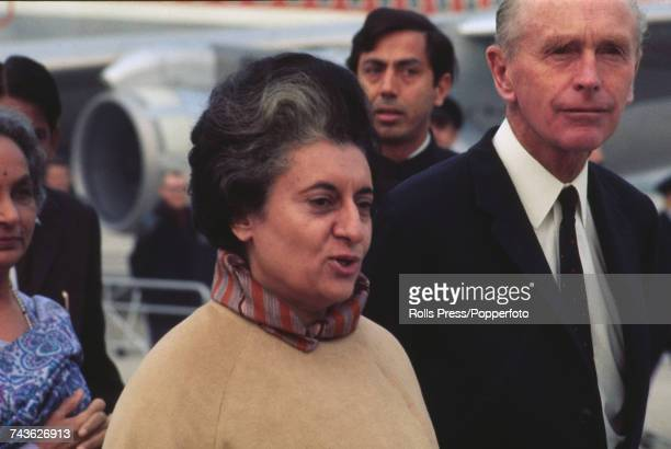Prime Minister of India Indira Gandhi pictured together with British Conservative Party politician and Foreign Secretary Alec DouglasHome at Heathrow...