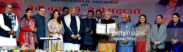 Prime Minister of India Narendra Modi releasing postage stamps as Haryana Governor Kaptan Singh Solanki Haryana Chief Minister Manohar Lal Khattar...