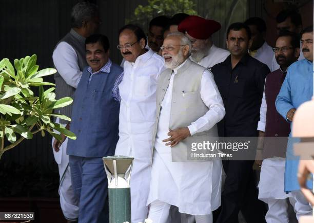 Prime Minister of India Narendra Modi talking to other ministers after attending the BJP Parliamentary Party Meeting at Parliament House on April 11...