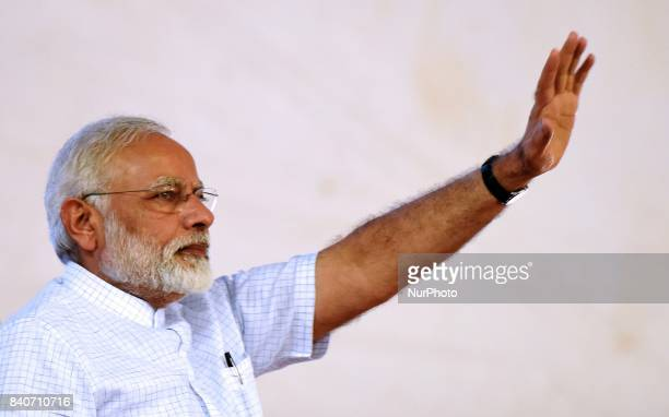 Prime Minister of India Narendra Modi waves at the crowd during the inauguration and foundation stone laying of various highway projects in Udaipur...