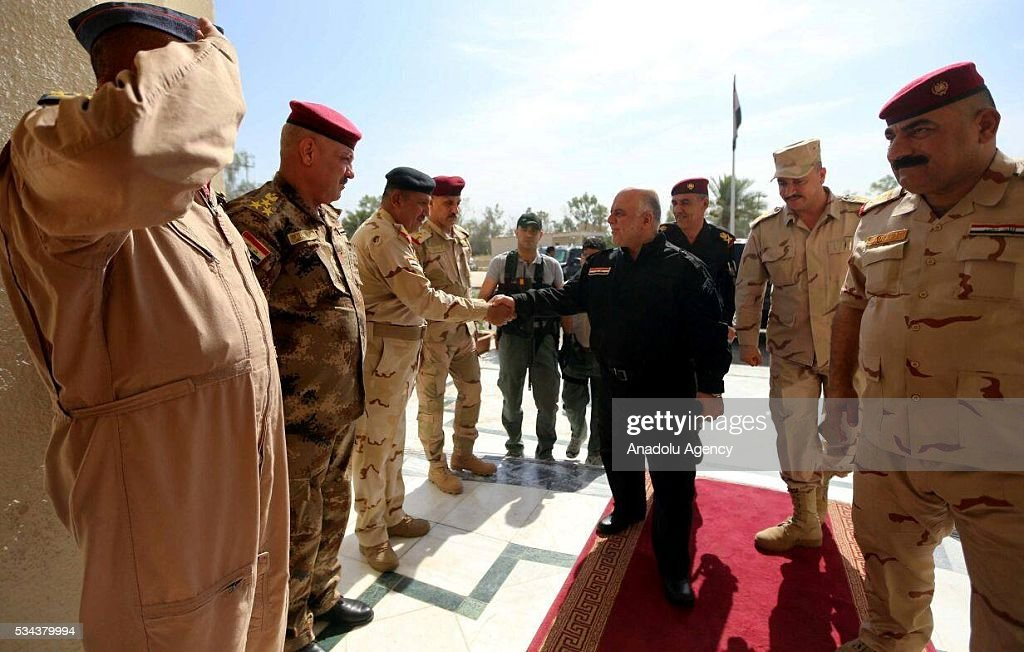 Prime Minister of Iraq Haider al-Abadi (C) visits Fallujah Operation Command in Anbar province of Iraq on May 26, 2016.