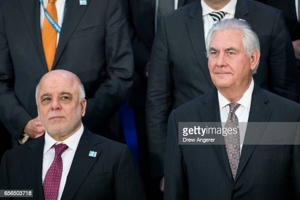 Prime Minister of Iraq Haider alAbadivand US Secretary of State Rex Tillerson stand next to each other during a group photo with leaders from the...