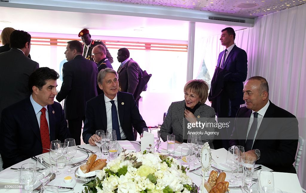 Prime Minister of Iraqi Kurdish Regional Government (KRG) Nechervan Barzani (L), British Foreign Secretary <a gi-track='captionPersonalityLinkClicked' href=/galleries/search?phrase=Philip+Hammond&family=editorial&specificpeople=2486715 ng-click='$event.stopPropagation()'>Philip Hammond</a> (2nd R), Turkish Foreign Minister Mevlut Cavusoglu (R) and Member of the Canadian House of Commons Lynne Yelich (2nd R) attend a lucnh in a ferry crossing the Sea of Marmara in Gallipoli peninsula to attend commemoration ceremony in Canakkale marking the 100th anniversary of the Canakkale Battles on April 24, 2015.