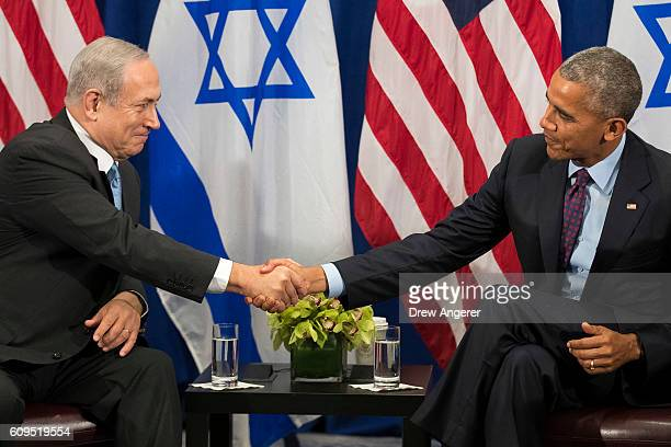 Prime Minister of Israel Benjamin Netanyahu shakes hands with US President Barack Obama during a bilateral meeting at the Lotte New York Palace Hotel...