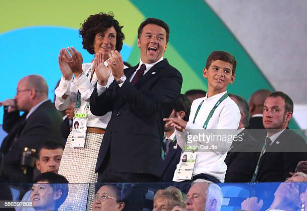 Prime Minister of Italy Matteo Renzi his wife Agnese Landini and their son applauds the italian delegation during the opening ceremony of the 2016...