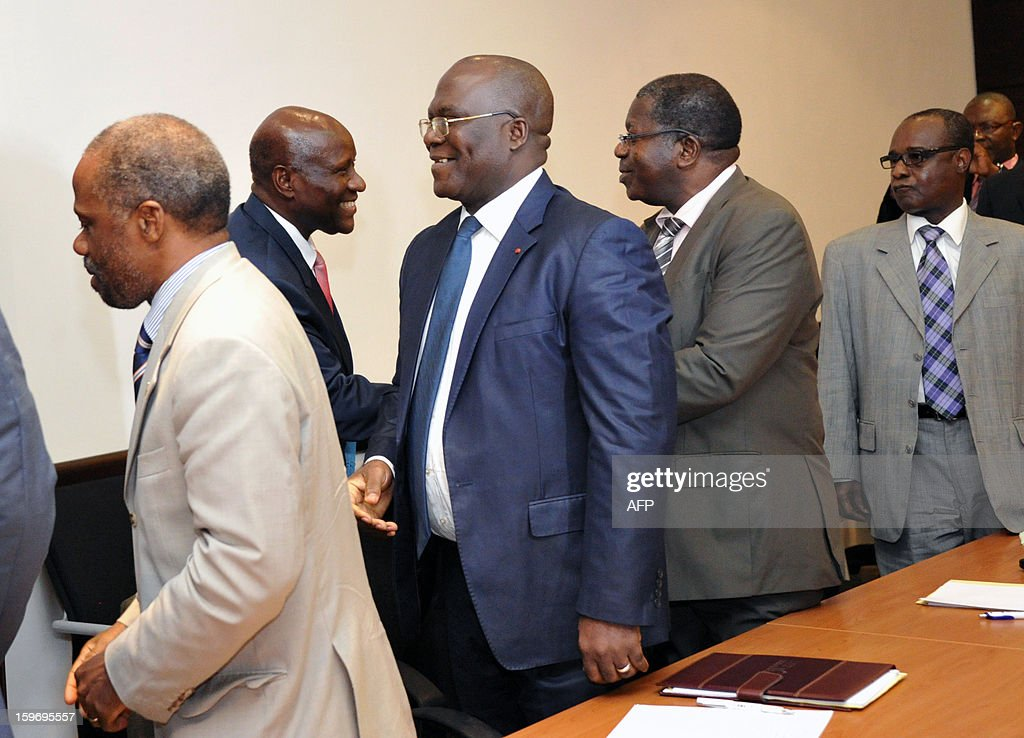 Prime Minister of Ivory Coast Daniel Kablan Duncan (2ndL) shakes hands with leaders of ex-president Laurent Gbagbo's Ivorian Popular Front (FPI) party, FPI's interim president Sylvain Miaka Oureto (2ndR), Michel Amani N'guessan (C) and Danon Djedje (L), on January 18, 2013 prior to a meeting at the Prime Minister office in Abidjan. AFP PHOTO/ SIA KAMBOU