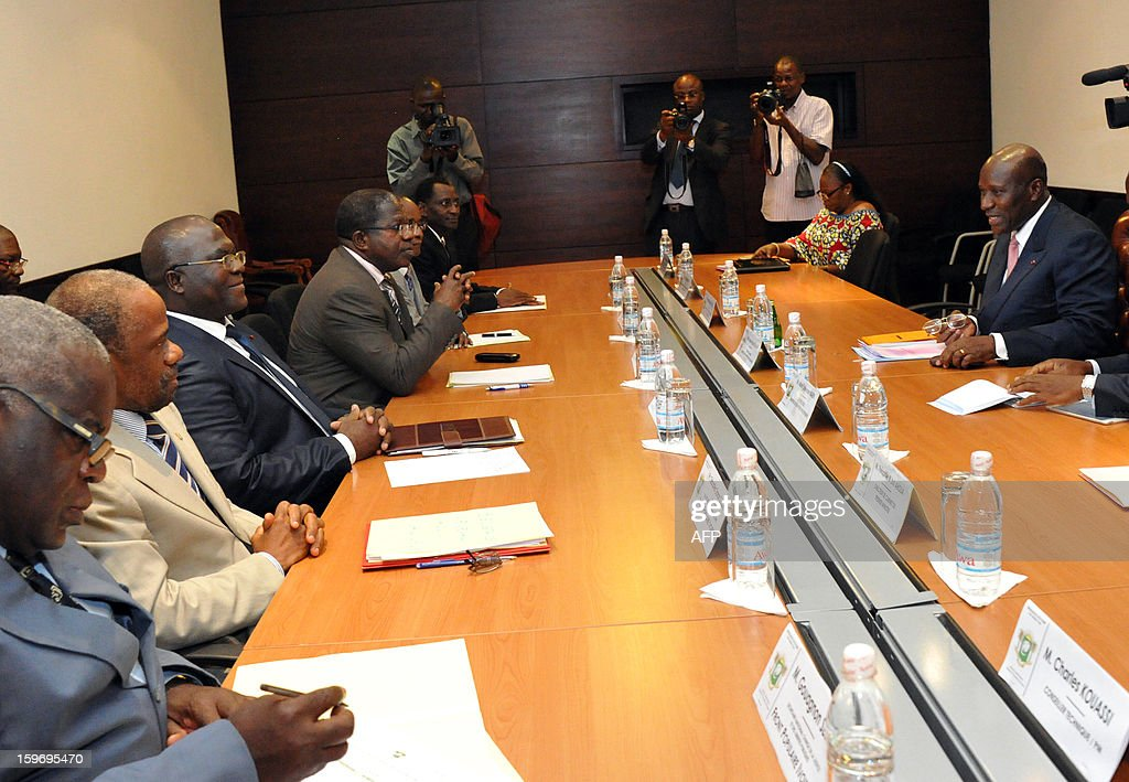 Prime Minister of Ivory Coast Daniel Kablan Duncan (R) speaks to leaders of ex-president Laurent Gbagbo's Ivorian Popular Front (FPI) party, FPI's interim president Sylvain Miaka Oureto (4thL), Michel Amani N'guessan (3rdL) and Danon Djedje (2ndL), on January 18, 2013 during a meeting at the Prime Minister office in Abidjan. AFP PHOTO/ SIA KAMBOU
