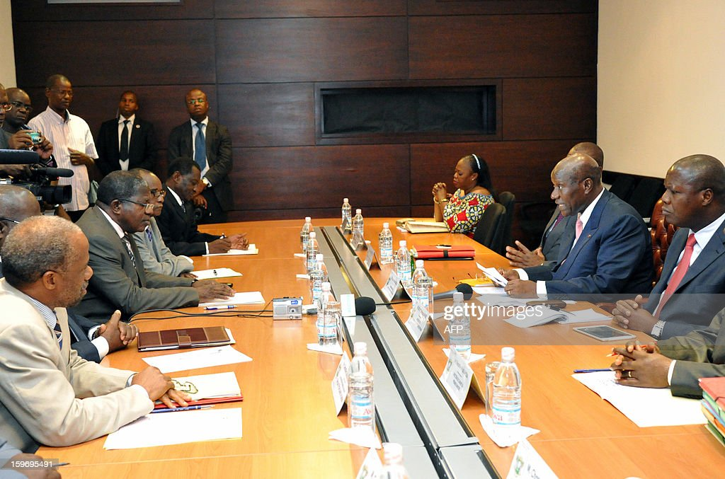 Prime Minister of Ivory Coast Daniel Kablan Duncan (2ndR) speaks to leaders of ex-president Laurent Gbagbo's Ivorian Popular Front (FPI) party, FPI's interim president Sylvain Miaka Oureto (2ndL) and Danon Djedje (L), on January 18, 2013 during a meeting at the Prime Minister office in Abidjan.